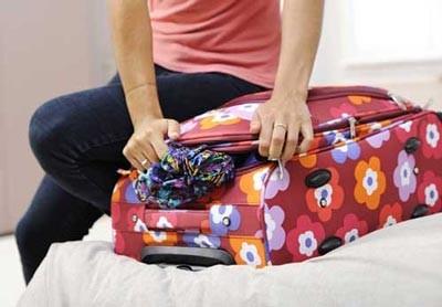 بستن سه سوته چمدان برای سفر