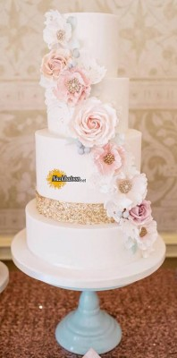 stunning-metallic-wedding-cake-with-blush-cascading-flowers